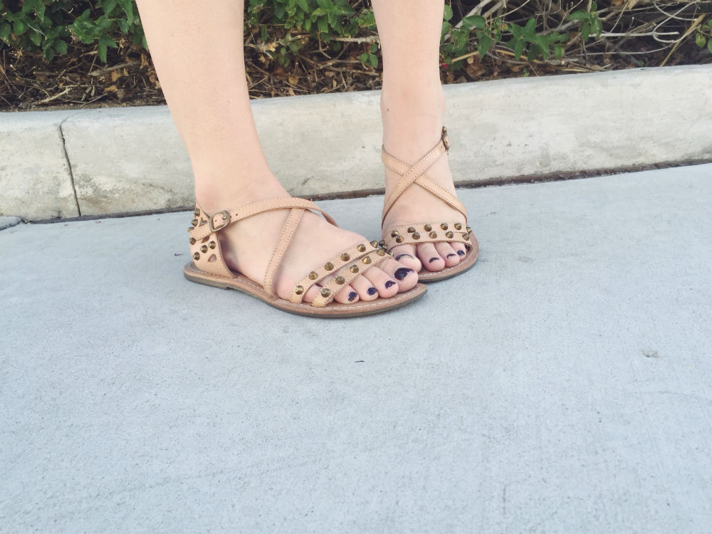 Tan studded sandals.